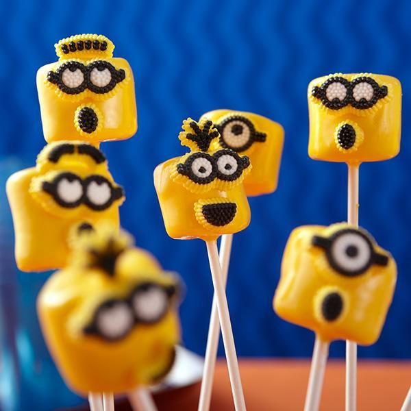 Mischievous Minion Marshmallows - They're despicable and delectable! Dip marshmallows in Candy Melts candy and add fun Minions Icing Decorations for a party treat that everyone will love.