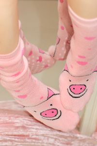 Tubular Pig Socks - This little piggy has grippy bottoms. This little piggy has no heels. This little piggy fits everyone. This little piggy causes squeals of joy. This little piggy went online & bought some & had them shipped for free! Thick, squishy & terry lined inside, very comfy.