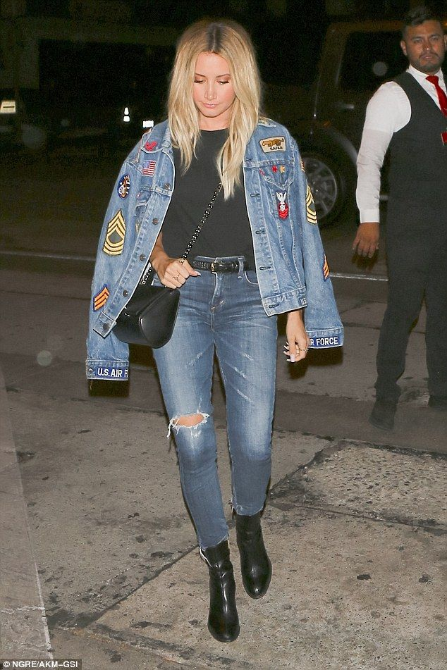 Mixing it up: The star went for a retro look with a denim jacket covered in colorful patch...