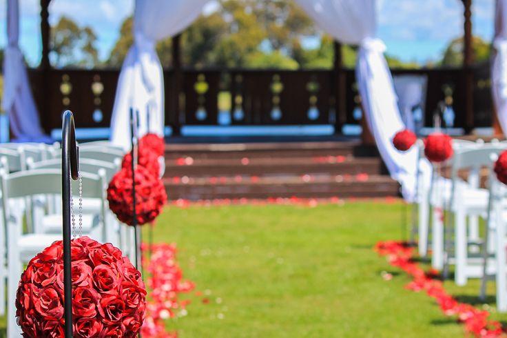 Wedding ceremony aisle, red roses ball, wedding ceremony flowers,   -Tamar Valley Resort
