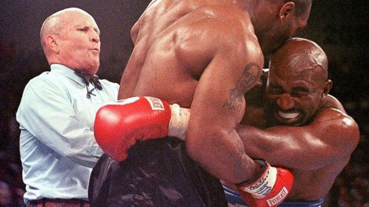 June 28, 1997 Boxer Mike Tyson bites a big chunk off Evander Holyfield's ear in the 3rd round of a boxing match. He was disqualified. :: Evander Holyfield's Hilarious Tweet After World Cup Bite