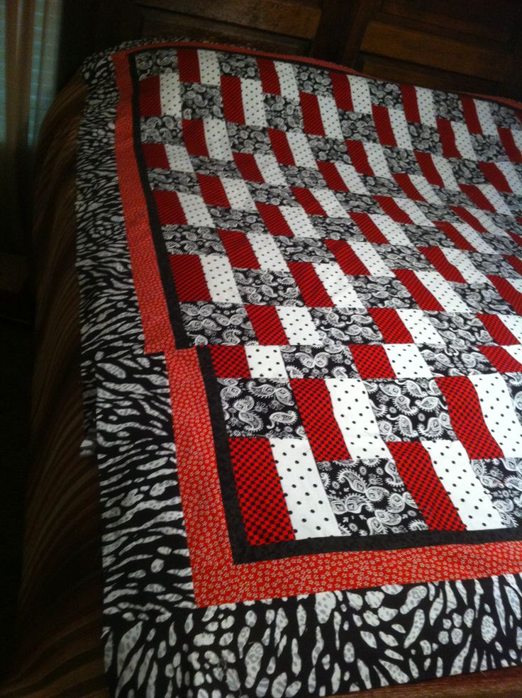 """Pattern called """"Three's a Quilt"""" -- used three fabrics for the top. I have added borders. This is prior to it being quilted and bound."""