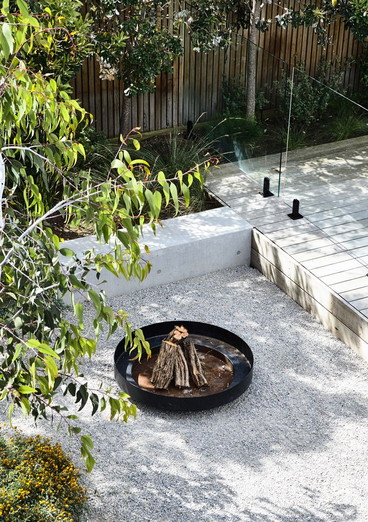 Designed by Acre - Munro Street. www.acre.com.au Photo by Derek Swalwell. Construction by Powda. Fire bowl shown in sunken seating area on crushed rock toppings