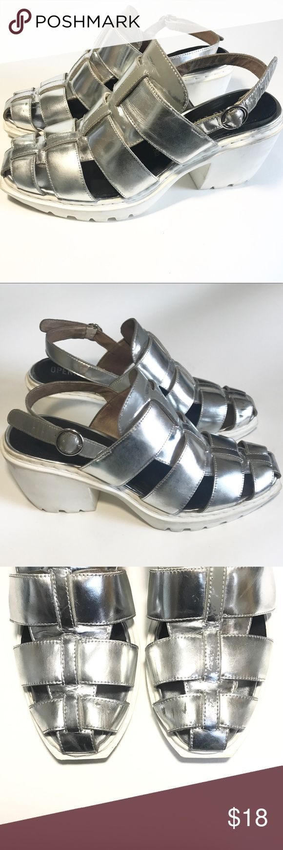 OPENING CEREMONY Silver/White Woven Platforms Silver/white woven slingback platform sandals. Size 7.5/8 Can be worn with socks in the winter for a trendy look or paired with shorts in the summer months. Priced as is, condition: ok - good, photos of wear are included. Opening Ceremony Shoes Platforms