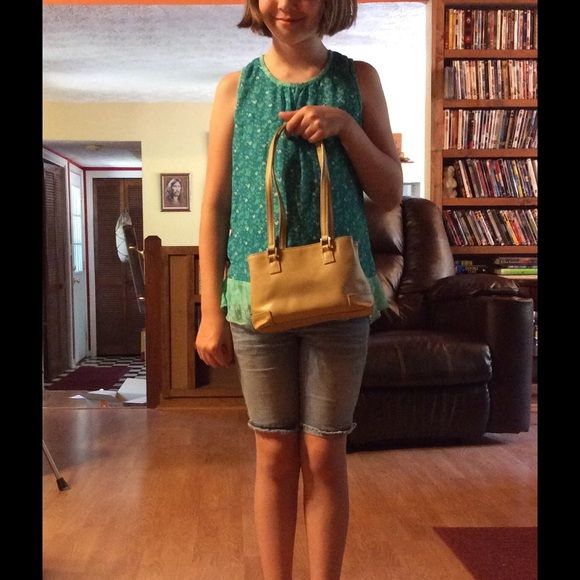 NEW PIC ADDED! LIKE NEW! SUPER CUTE SMALL TAN BAG This little bag is awesome! Excellent condition, soft and so roomy to be such a small purse! Great for shopping or running errands. Would make a nice bag for young ladies too! Liz Claiborne. Liz Claiborne Bags