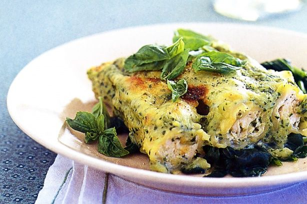Basil chicken cannelloni on wilted spinach