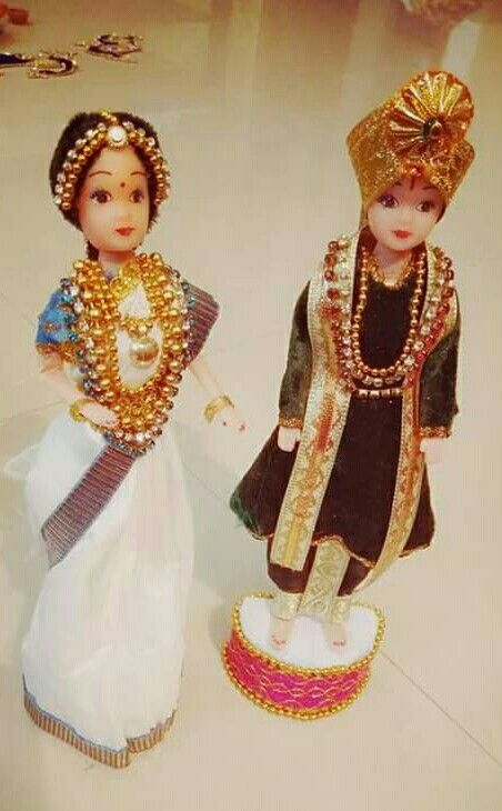Dolls dressed as bride on groom......