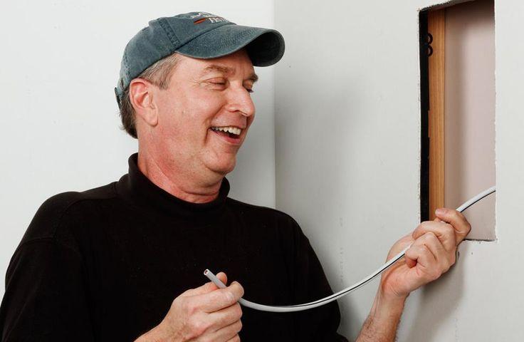 Crutchfield advisor Norm installing wire.