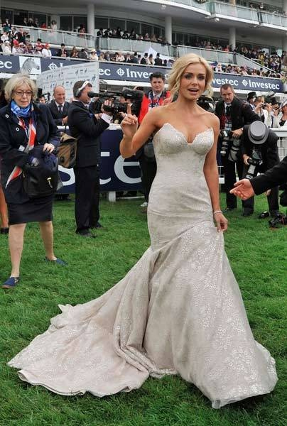 Welsh opera star Katherine Jenkins crosses the course at the Epsom Derby festival.