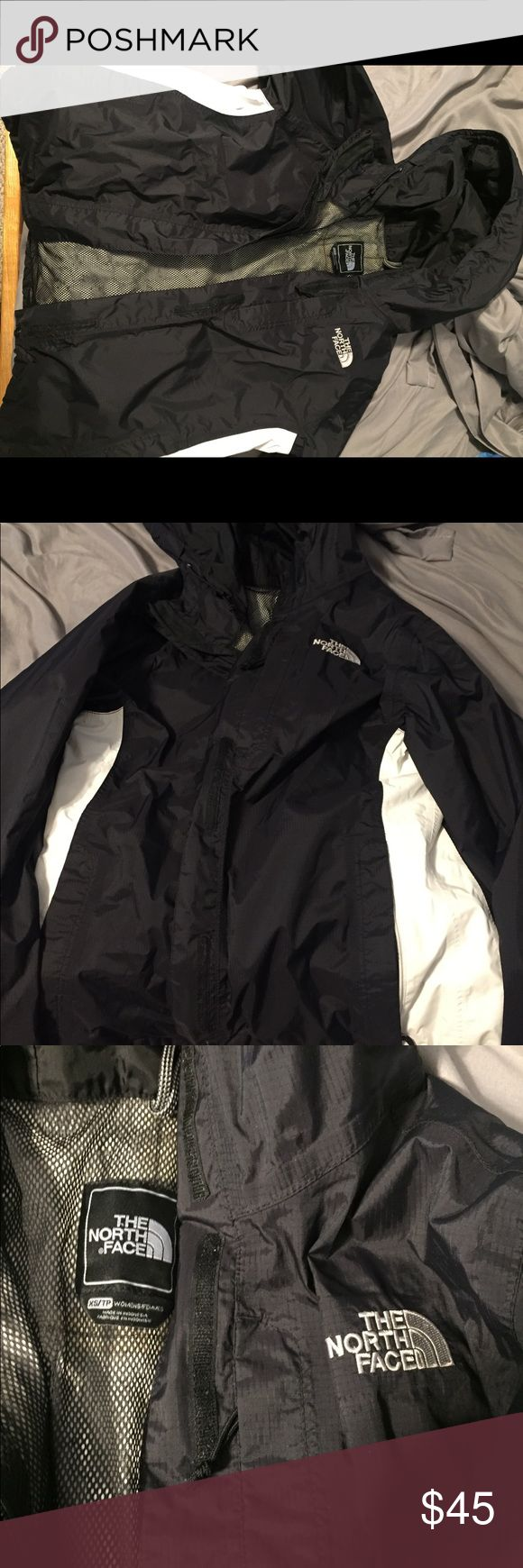 Black/white North Face rain jacket. Black/white rain jacket. Size XS. Hardly worn. North Face Jackets & Coats