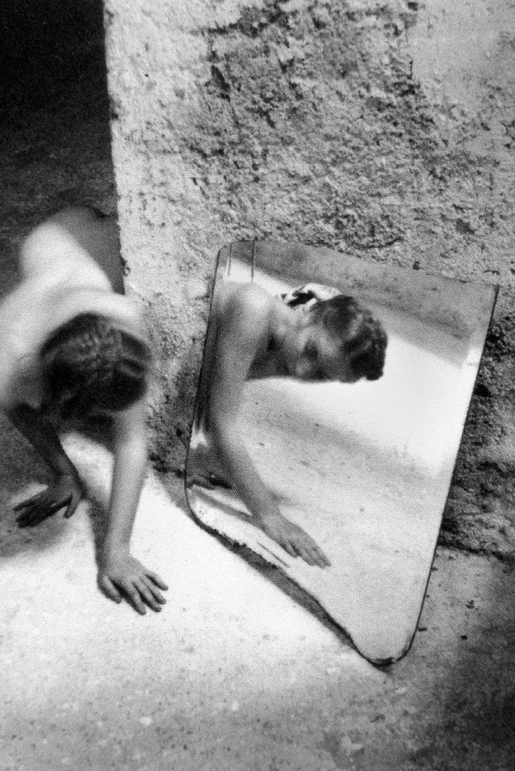 Francesca Woodman | woman | crawling | mirror | reflection | stone floor | rustique