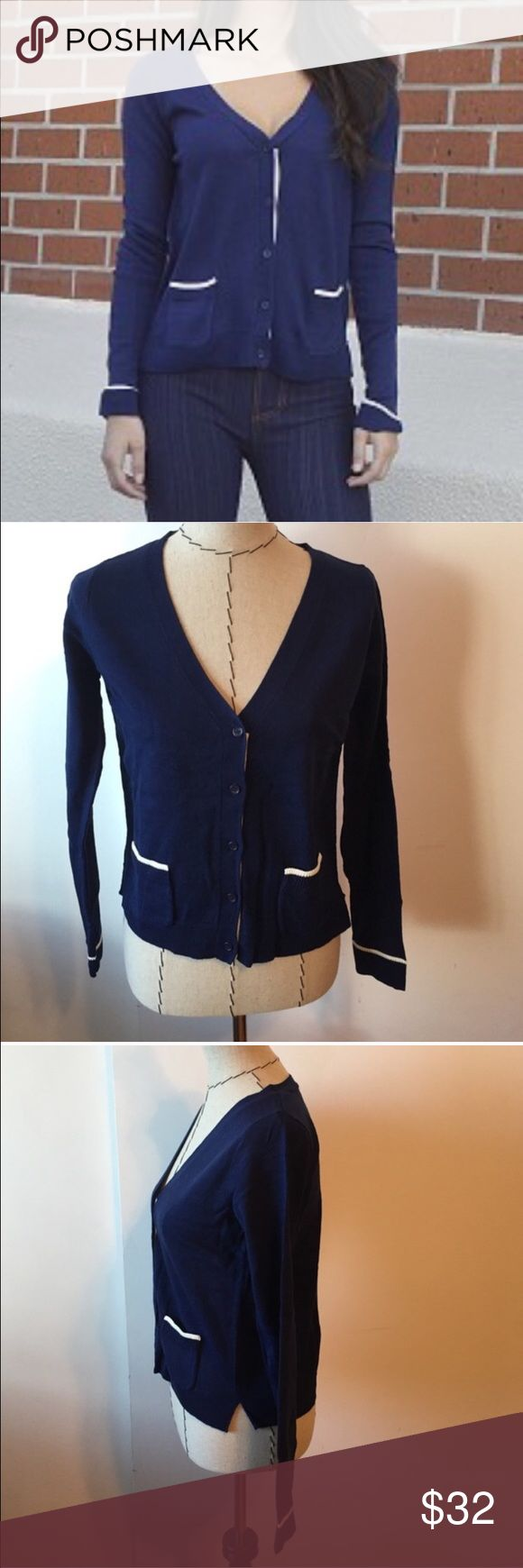 Blue and white cardigan Cute preppy cardigan! Never worn. No buttons are missing. Fits true to size. Cute blue cardigan with white accents. Has two pockets on the front. Sweaters Cardigans