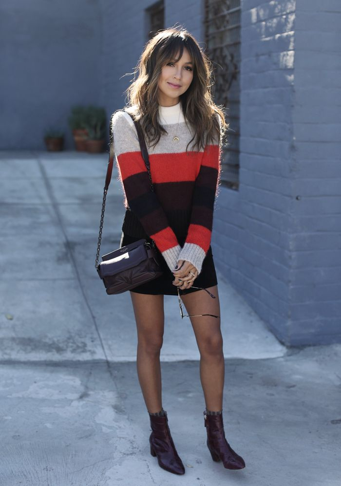 Pair a winter sweater with a leather mini skirt and sheer black tights for the perfect festive holiday outfit