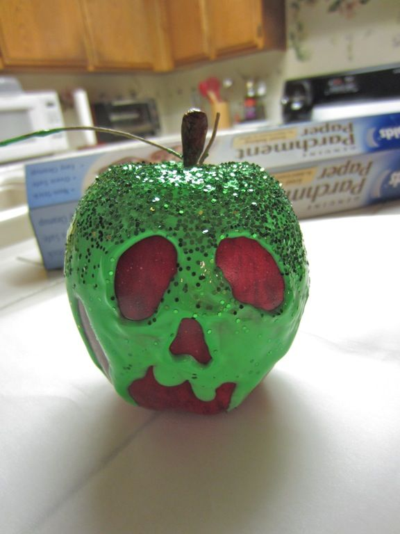 Snow White Poisoned Apple -fake apple,  at Michaels  -green fabric paint, at Michaels (definitely could have gone with the smaller, cheaper bottle)  -green glitter, not sure of the cost 'cause I found this for freeeeee  -twine, also already had this  -paintbrush  (not pictured)  -felt pen  -Elmer's glue (probably don't need this, see step 4)  -paper towels  -small dish  -tid bit of water