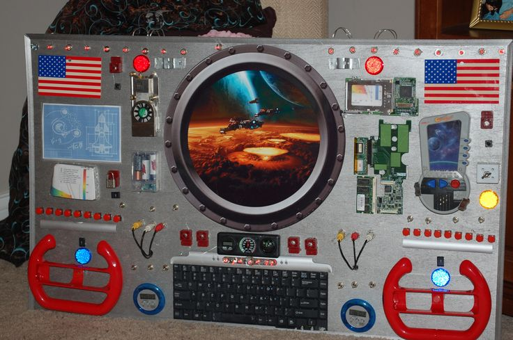 """This is a Space Command Center I built for my two grandsons for their new space themed room. With a LOT of help from hubby and their other grandma. The lights across the top and above the keyboard flash red, the """"countdown"""" timers work, and the hand-held video game (Asteroid Blaster) works for sound effects and playing. The rest of the buttons, switches, locks, knobs and cables work only with their imagination. Hope they love it!"""