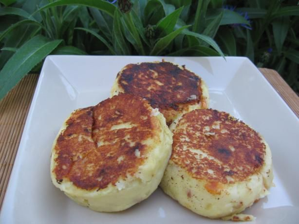 Llapingachos - Potato Cakes Filled With Cheese from Food.com:   								Llapingachos are potato patties filled with cheese, then sauteed to a golden brown for an appetizer or snack in Ecuador. If your not in a hurry they will fry better if the patties are chilled for about 45 mins before frying. When fried warm they will be ok but will sloppier and not hold together quite as well