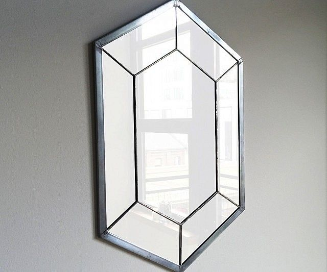 It's dangerous to go out of your home before giving yourself a quick once over. Place this Legend Of Zelda rupee mirror by the front door and you'll always have a convenient little place to check your appearance before you face the world.