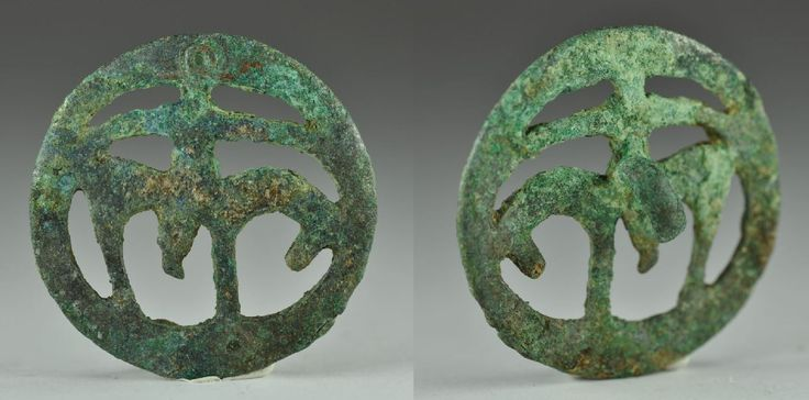 Luristan Amlash bronze pendant with horse and horseman, 1st millenium B.C. Near Eastern bronze pendant with horse and horseman, 4 cm diameter. Private collection