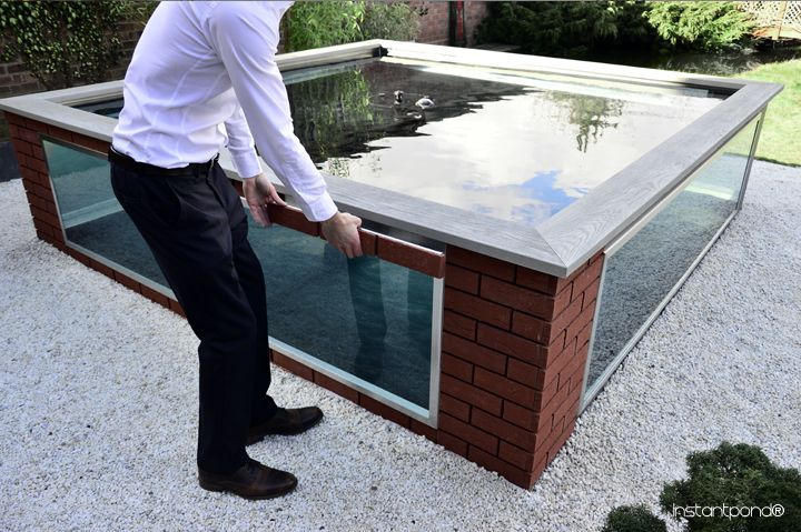 Build a Koi Pond: Raised Stainless Steel Framework Pond with real brick slips.  http://www.atlanticagardens.com/instantpond