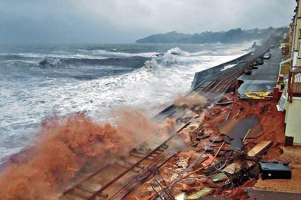 The damaged railway line at Dawlish, Devon