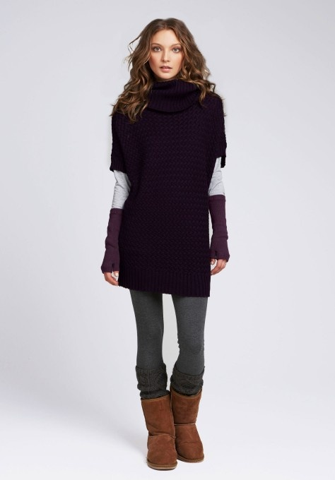 One of the best long tops to wear with leggings is a long, slim sweater. This rich olive one has a flattering boatneck neckline that creates width up top and makes your shoulders look broad, which in turns makes you bottom half look slimmer.