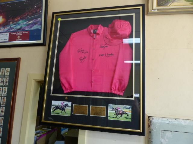 Horse racing memorabilia is always popular. This item is a framed Lontiro horse racing silk, signed by Darren Beadman, Darren Gauci, and John Hawkes. Limited edition 1 of 2