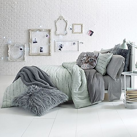 From at home to on campus, the Glam Script Reversible Comforter Set brings a fresh and fun look to your bedroom style. The cotton sateen set features a chic pewter script print on soft aqua, reversing to a pewter herringbone print on aqua.
