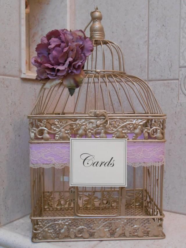 This beautiful champagne gold birdcage wedding card holder would be the perfect accessory to add to any wedding gift table. Cage has been adorned