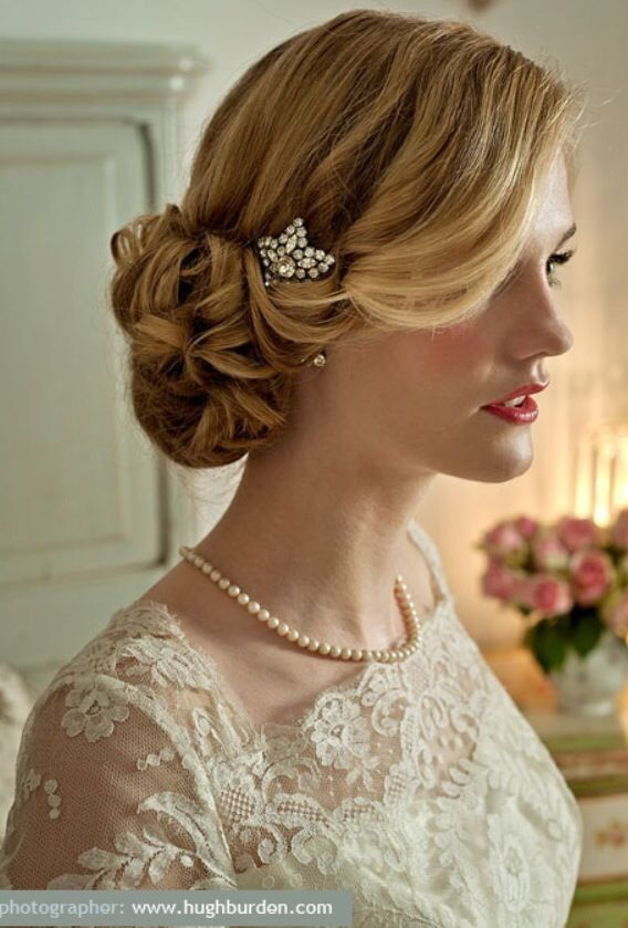 Love the tucking and low comb, also the hair around the face - very downton abbey!