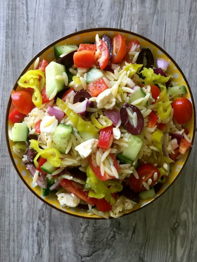 Greek Orzo Pasta Salad is a summer pasta salad mixing orzo, crisp vegetables, feta cheese and a light Greek dressing. You can make this salad in advance and it can be used for up to 4 days after you make it making it a great choice for weekly lunches, parties and your Memorial Day BBQ.
