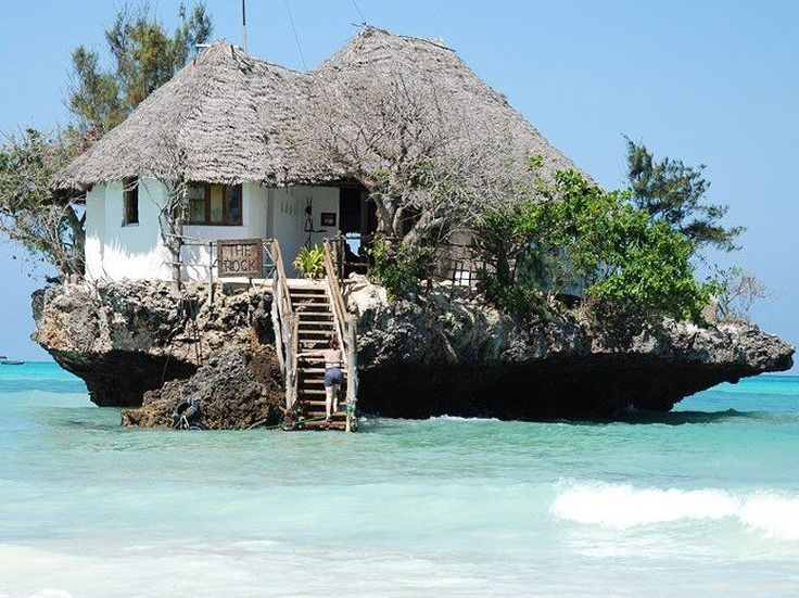 The Rock, Zanzibar, Africa. What began as a fisherman's post off the coast of Michanvi Pingwe beach has become the location of one of Zanzibar's most iconic seafood restaurants. During low tide, guests can walk from shore, but during high tide, the eatery provides boat service. Photo via Condé Nast Traveler.