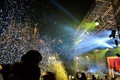 Nadia Mikushova. People are watching New Year's concert at Milan Duomo square. stock photo