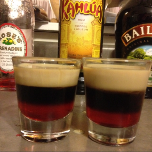 Chocolate covered cherry. Grenadine, kahlua, and baileys in that order poured over a spoon. Yum!