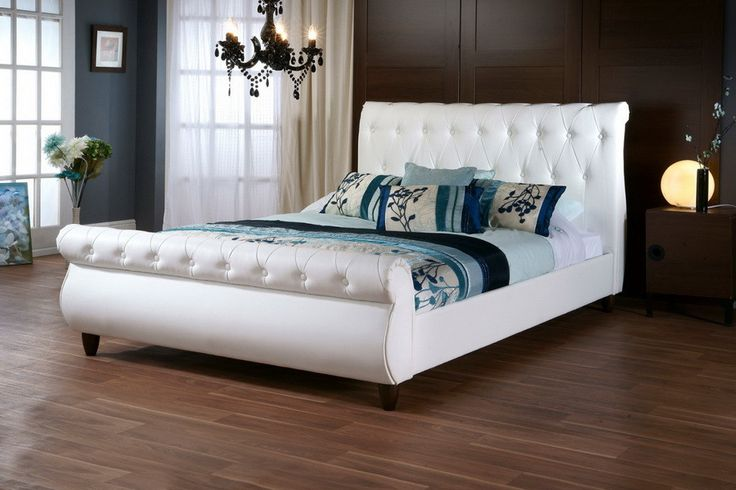 Baxton Studio Ashenhurst White Modern Sleigh Bed with Upholstered Headboard - Queen Size - White This sumptuous sleigh bed showcases old world charm with abundant detail. The Malaysian-made queen-size