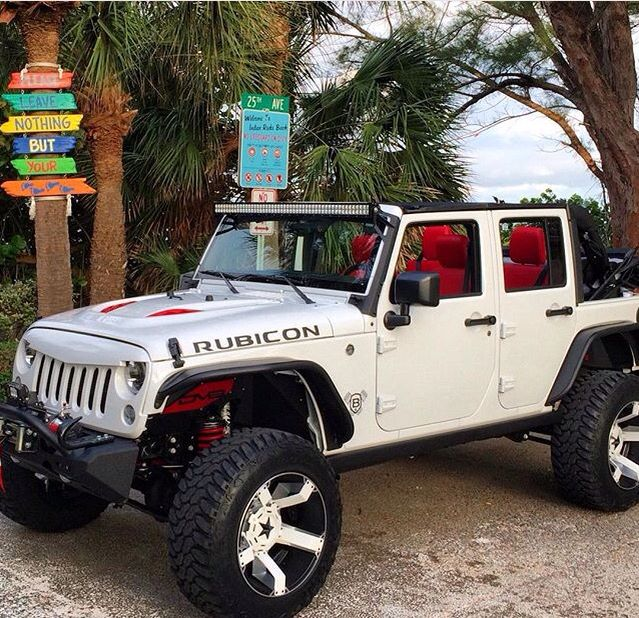 WHITE RUBICON WITH CUSTOMIZED RED INTERIOR & RED HOOD VENTS! CUSTOM WHITE WHEELS! I LOVE IT!