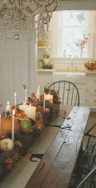 love the bling of the chandelier with the rustic table and fall vignette