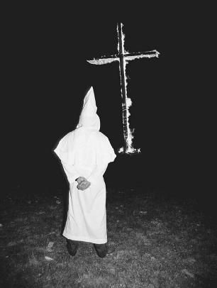 an overview of the kkk and the cross Documentary detailing the history of the ku klux klan a racist far right extremist movement founded in 1866 which reached unprecedented popularity during th.