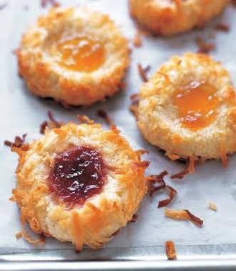 These are traditional jam thumbprints updated – sweet shortbread dusted with coconut and a dollop of raspberry or apricot jam. They're just like the ones your grandmother made - but even better! This is a classic holiday cookie that adults and kids will love.