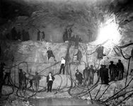 Nearly 5,000 people worked on the HAWK's NEST TUNNEL, which created a shortcut to a hydroelectric power plant at Gauley Bridge.  Rinehart & Collins was the subcontractor, hired by UNION CARBIDE to build a tunnel at breakneck speed.  It was hellish work. Most who toiled inside the tunnel were black, working 10-hour shifts, 6 days a week, earning 22.5 cents per hour when a loaf of bread cost 8 cents. Some died in rockslides; others crushed by heavy machinery. Most died a breath at a time. . .