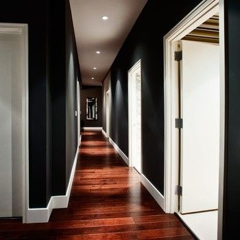 black walls (maybe even just dark dark gray) + white trim + rich wood+lighting--something about this is very attractive.