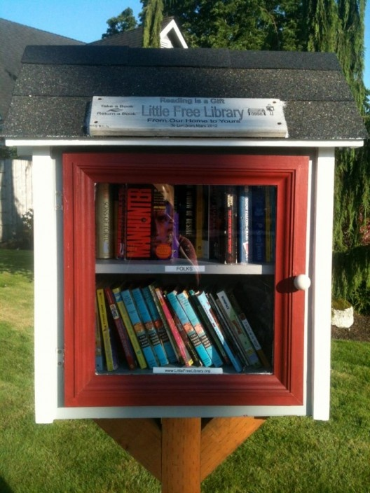 """Little Free Library"" outside container for all in the neighborhood. Sounds like a great idea!!!"