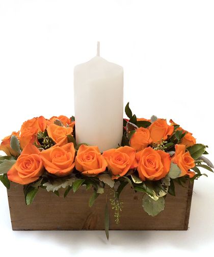 A weathered wooden box filled with brilliant roses will bring warmth to any home during the autumn months. This versatile design may be used as a gorgeous #centerpiece or decorate any room, foyer, or table.