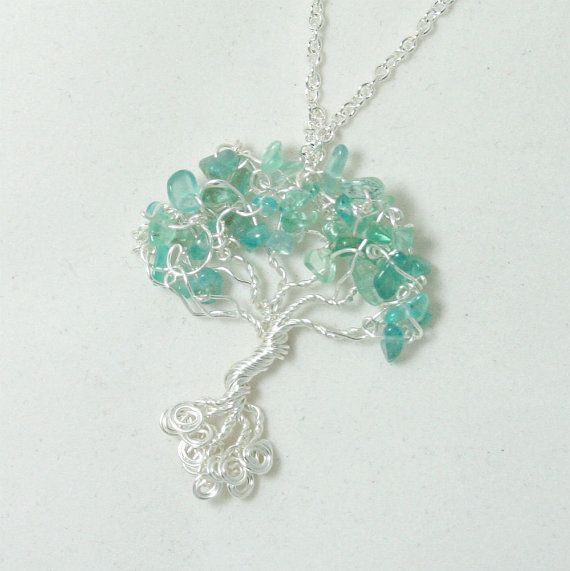 Tree of life pendant with blue aigue marine by treasuresoftrees