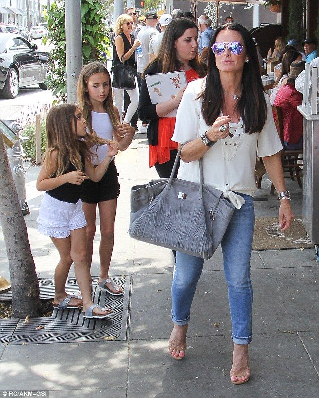 Meal time: It seems Kyle Richards decided to start the weekend early as she stepped out for a laid-back lunch with two of her daughters and husband Mauricio Umansky on Friday