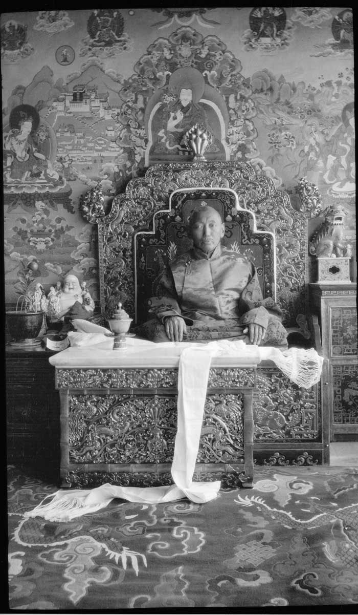 The 13th Dalai Lama sitting on a throne. At Norbulingka, around 1932.