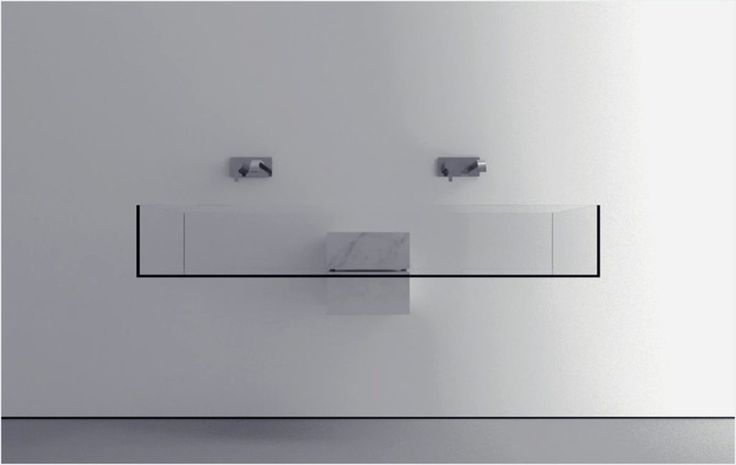 Minimalist Bathroom Sink With An Almost Surreal Appearance: Kub Basin | This minimalist bathroom sink captured our attention with its almost surreal look. The master-mind behind the futuristic bathroom item is Bulgarian designer Victor Vasilev, who studied architecture in Copenhagen, Denmark, and currently lives in Milan, Italy. His portfolio reveals a modern-minimalist approach, with each design having its own twist.<!--more-