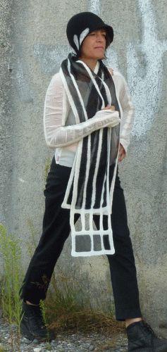 I like the insets in the sleeve.  scarf in silk & merino felt  www.filz-und-kunz.de