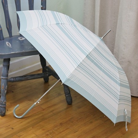 """Cloudy Days Striped Umbrella 22.99 at shopruche.com. Light up a rainy day with this charming off-white umbrella with light blue stripes. It is finished with a patent crook handle and a button to quickly unfold the canopy.  37"""" canopy Approx. 33"""" length"""