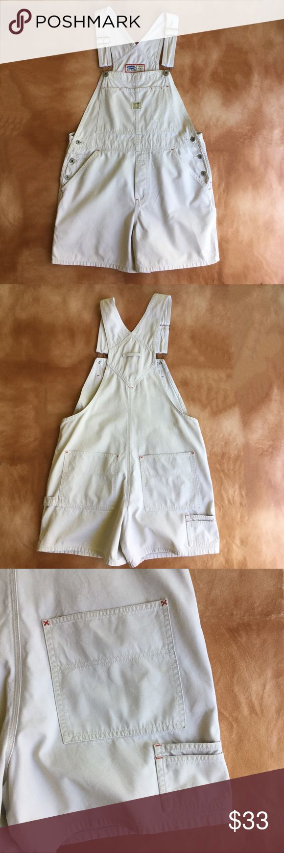 """Vintage 90's Old Navy Overalls Vintage 90's Old Navy overalls.  Size M"""" Light khaki with red stitching. These are a nice roomy cut. Please note the label in the last photo. Too hot of an iron was used, and the label has melted a little. This caused a small stain just above the label. Not really noticeable when wearing. Hips measured flat 20 in., inseam 5 in. Old Navy Jeans Overalls"""