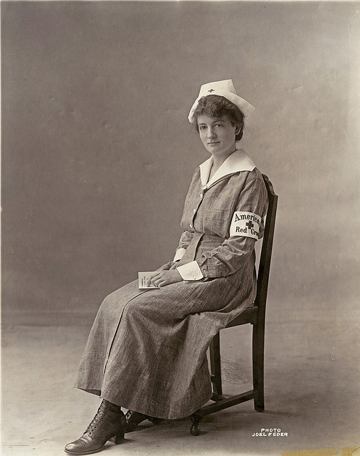 "This is the nurses' uniform that our wounded know best - the gray cotton crepe working uniform of the Red Cross Army and Navy Nurse, which make its wearer ""the best dressed woman in the world."" Gray is an innovation used abroad made necessary by the laundry problem in France. The Red Cross brassard is worn only by nurses serving directly under the Red Cross: World War, Red Crosses, Wwi Nur, Nurse Uniforms, Crosses Nur, Nur Uniforms, Nursing Uniforms, American Red Cross, Antiques Photographers"